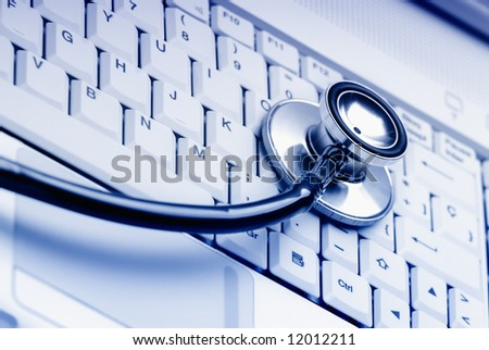 Computer keyboard with stethoscope. Good technical support symbol