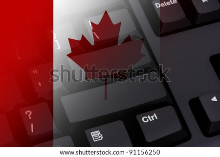 Computer keyboard with the Canadian flag on it, Internet in Canada - stock photo