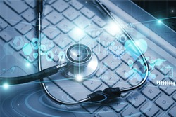 Computer keyboards and black stethescope with medical illustration