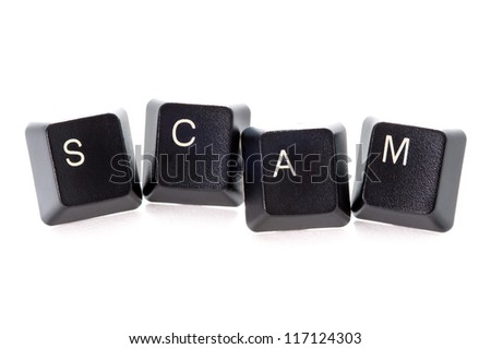 computer keys spelling the word scam concept