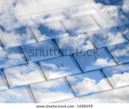 Computer keys superimposed on cloudy sky. - stock photo