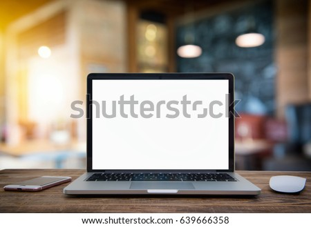 Computer Laptop with blank screen on  table of coffee shop blur background with bokeh, desk  blank work office mockup monitor