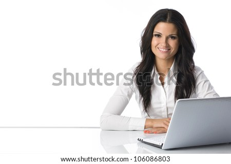 Computer. Laptop.Woman.Girl. Businesswoman.Girl working at the laptop. Studio.White background.Space.Smiling. Education center. Business seminar.