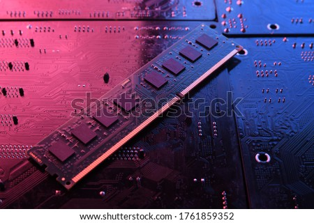 Photo of  Computer memory RAM on circuit motherboard background . Close up. system, main memory, random access memory, onboard, computer detail. Computer components .