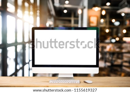 Computer Monitor, Keyboard, coffee cup and Mouse with Blank or White Screen Isolated is on the work table in the coffeeshop   #1155619327