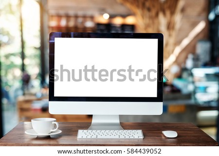 Computer Monitor, Keyboard, coffee cup and Mouse with Blank or White Screen Isolated is on the work table in the coffeeshop