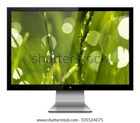 Computer Monitor with green greass on screen background. Isolated on white