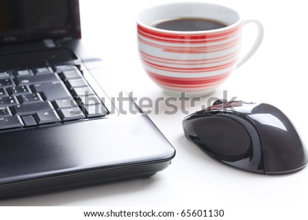 computer mouse and coffee cup