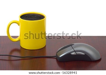 Computer mouse and coffee cup isolated on white background