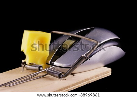 Computer mouse and mousetrap isolated on black background