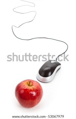 Computer Mouse and red apple close up