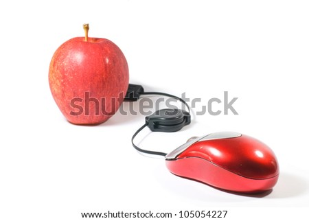 Computer Mouse and red apple on white background