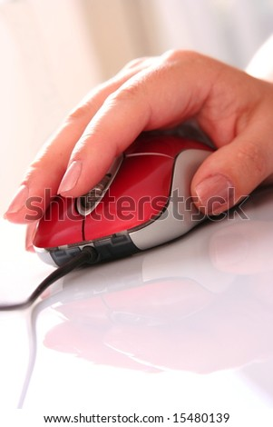 Computer mouse and women's hand