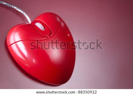 Computer mouse in form of heart in isolation
