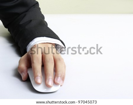 computer mouse in hand - stock photo