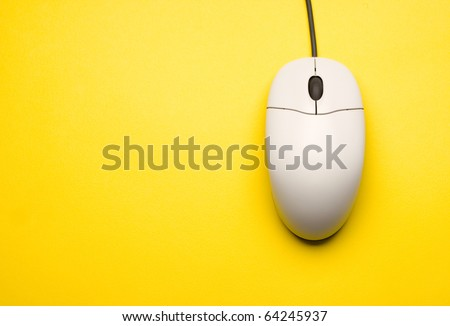 Computer mouse isolated on the yellow background