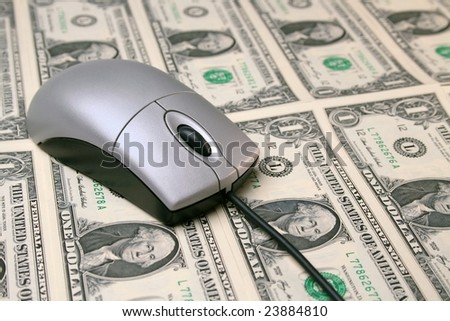 Computer mouse on money concept shot for finances or shopping