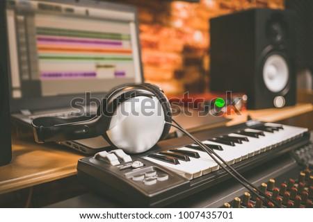 Home recording studio with professional monitors and midi