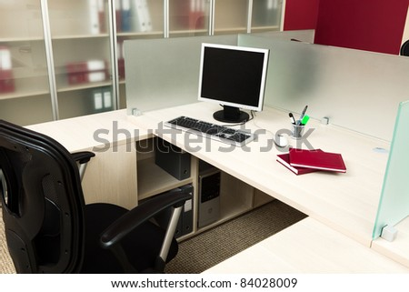 computer on a desk in a modern office