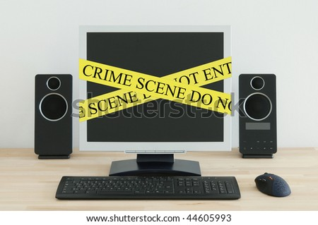 Computer on a desk with a Crime Scene label.
