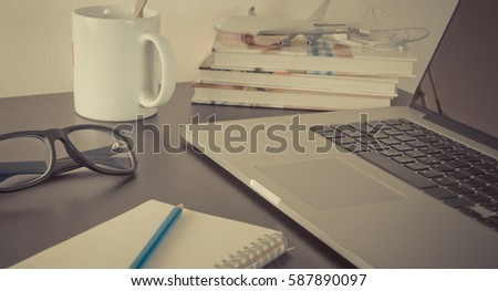 Computer on travel agency office table with morning coffee and notebook #587890097
