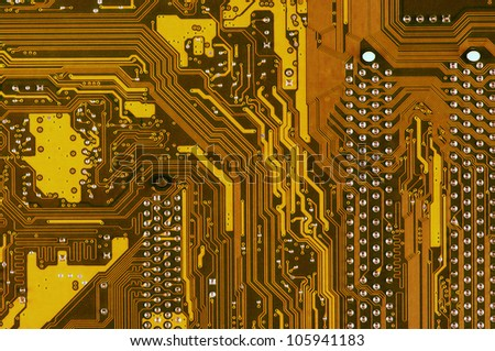 Computer part: downside of circuit board close-up.