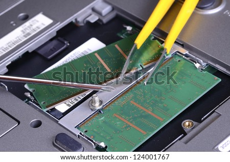 Computer parts and repair tools concept of troubleshooting and maintenance
