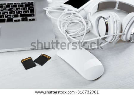 Computer peripherals and laptop accessories on white wooden background #316732901
