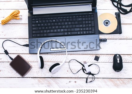 Computer Peripherals & Laptop Accessories. Composition on white wooden board. - Shutterstock ID 235230394