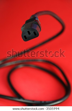 computer power cable set against red background