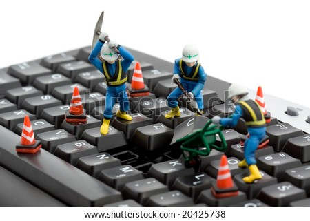 computer repair concept - workers repairing keyboard - stock photo