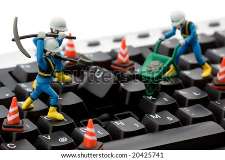 computer repair concept - workers repairing keyboard
