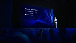 Computer Science Startup Conference: On Stage Speaker Does Presentation of New Product, Talks about Neural Networks, Shows New AI, Big Data and Machine Learning App on Big Screen. Live Event