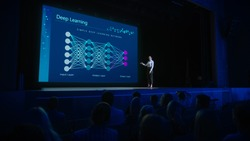 Computer Science Startup Conference: On Stage Speaker Does Presentation of New Product, Talks about Deep Learning, Shows New AI, Big Data and Machine Learning App on Big Screen. Live Event