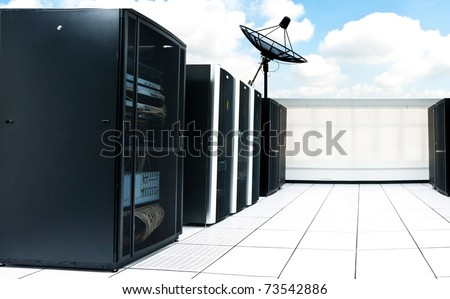 Computer server racks and satellite with blue sky