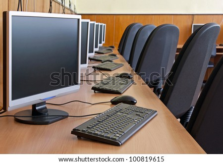 computer study lab. image with selective focus on first LCD monitor. stock photo