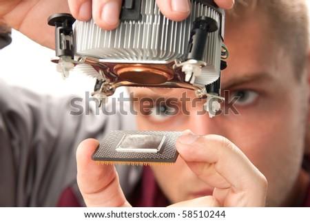 Computer support engineer installing processor