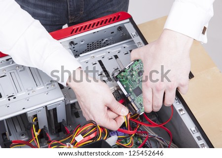 computer support engineer troubleshooting an office computer.