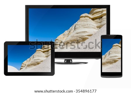 Computer technology, mobility and communication business concept: laptop or mini tablet computer, touchscreen smartphone and desktop monitor display screen TV isolated on white
