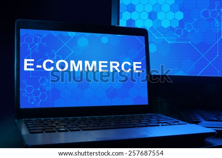 Computer with words e-commerce. Internet technology concept.