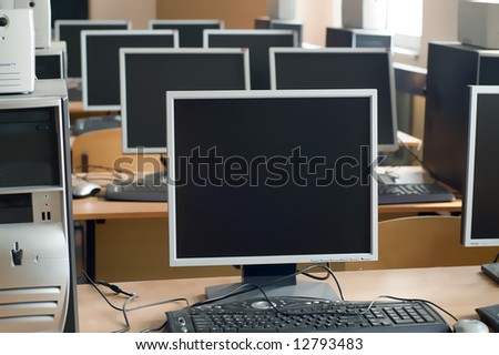 computers in a row in the university class