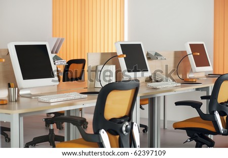 Computers with LCD screens in modern office