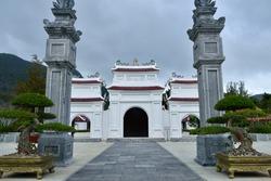 Con Dao Temple with Square Columns, Bonsai, and Clouds