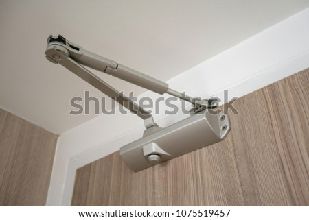 Concealed hydraulic buffering 90 degree positioning door closer the slide lever arm with a stop gate Cam structure. Automatic hydraulic device, leaver hinge door closer holder.