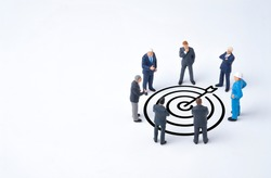 Concentrate setup objectives target and business goal ,Manager miniature figures standing and see in virtual black arrow and dartboard which print screen on white background.