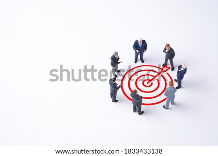 Concentrate setup objectives target and business goal ,Manager miniature figures standing and see in virtual red arrow and dartboard which print screen on white background.