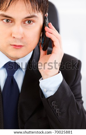 Concentrated business man talking on mobile phone