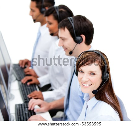 Concentrated business team with headset on  against white background - stock photo