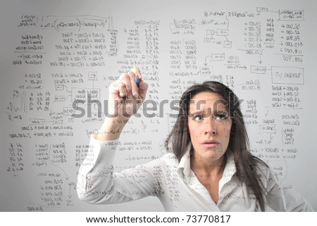 Concentrated businesswoman solving some complicated calculations