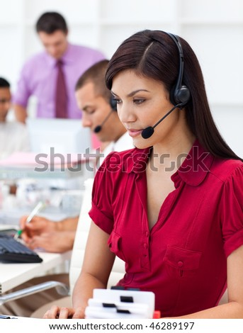 Concentrated  Businesswoman using headset in a call center